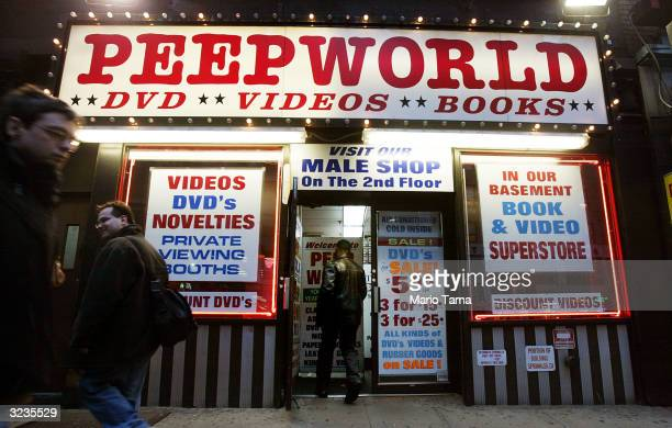 A man enters the Peepworld adult entertainment store in Times Square April 2 2004 in New York City Times Square's 100th anniversary is being...