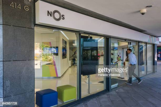 A man enters the public's attention area at the headquarters of Portuguese 'NOS Comunicacoes' a GSM/UMTS/LTE mobile operator on August 30 2017 in...