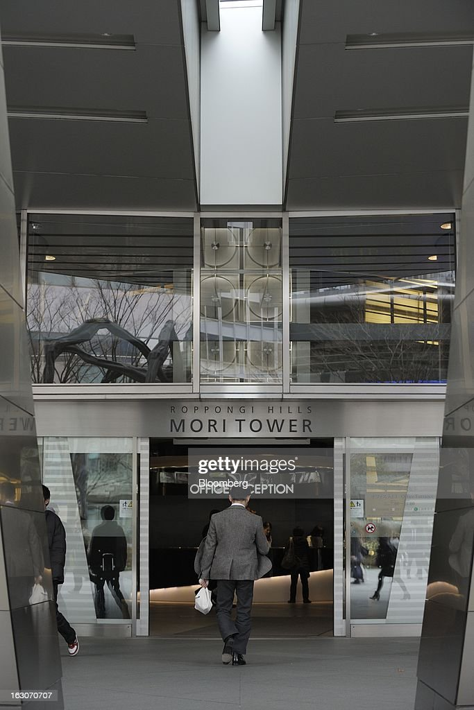 A man enters the Roppongi Hills Mori Tower, operated by Mori Building Co., in Tokyo, Japan, on Friday, March 1, 2013. Mori Building Co., Japan's biggest closely held developer, said it plans to attract global companies to its new building set to open in 2014, its biggest project since Roppongi Hills opened a decade ago. Photographer: Akio Kon/Bloomberg via Getty Images