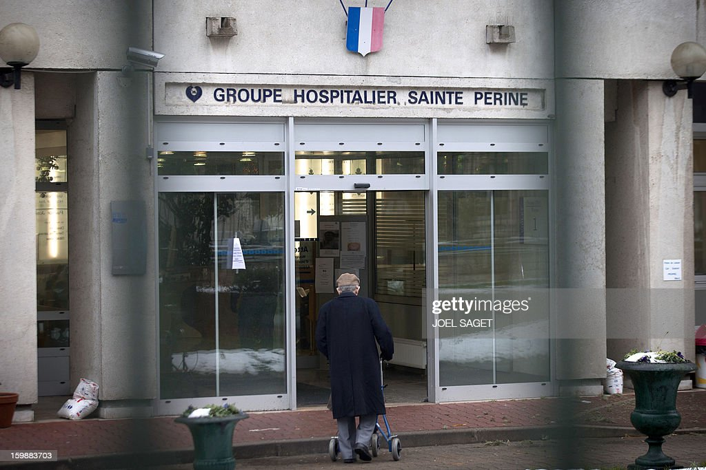 A man enters the Sainte Perine hospital in Paris, on January 22, 2013. A 90 year-old patient was found dead inside the hospital garden on January 21 after she left her room and evaded surveillance the night before. After taking a sleeping pill, the victim allegedly escaped her room, and when notified, hospital staff and police officers searched for her for several hours in vain. Her body was found in the cold garden the following day. AFP PHOTO /JOEL SAGET