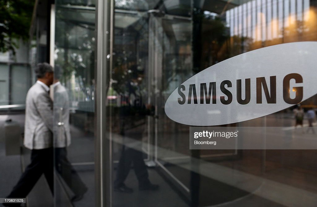 A man enters the Samsung Electronics Co. Seocho office building in Seoul, South Korea, on Tuesday, June 18, 2013. Facebook Inc. Chief Executive Officer Mark Zuckerberg, seeking to boost advertising sales from mobile devices, discussed potential partnerships with Samsung Electronics Co., according to the head of the South Korean companys handset division. Photographer: SeongJoon Cho/Bloomberg via Getty Images