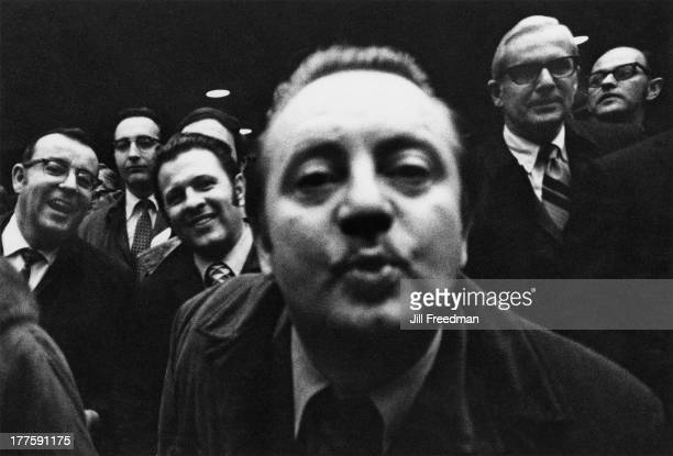 A man entertains his friends by making sounds with his mouth Madison Square Garden New York City 1971