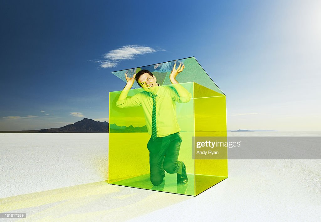 Man escaping box in desert.