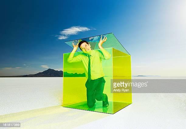 Man escaping box in desert.