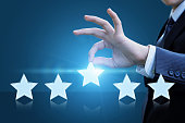 A businessman evaluates the service and gives it five stars.