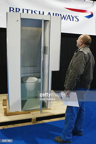 A man examines a Concorde Cabin Toilet on display during the 4Day Supersonic Webcast Auction of memorabilia from the recently retired British...