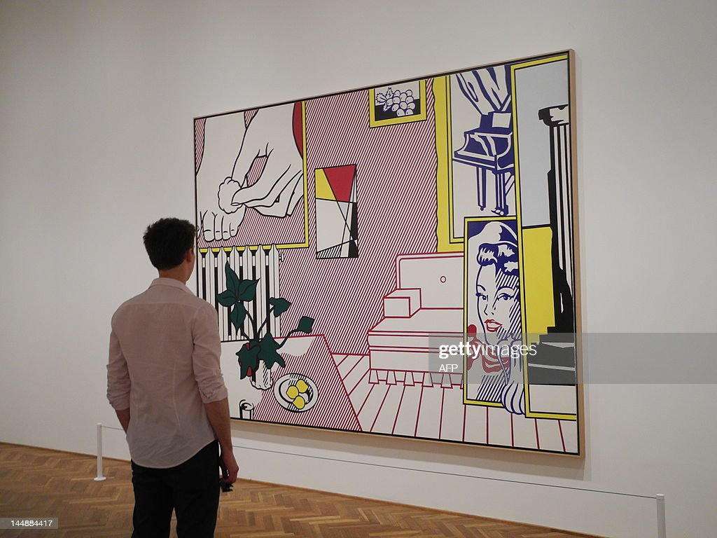 A man examines Pop art icon Roy Lichtenstein's Artist's Studio 'Foot Medication' during a preview of the first retrospective since his 1997 death at...
