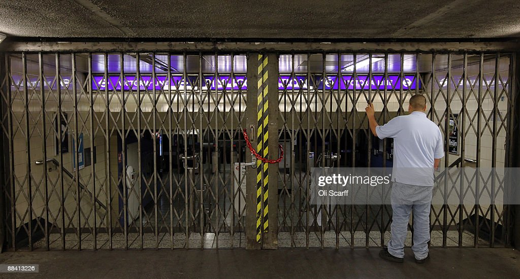 A man examines the closed shutters at Pimlico Underground Station due to RMT Union's tube strike on June 11, 2009 in London, England. A 48 hour strike began at 7pm on Tuesday after discussions over pay and working conditions between London Underground bosses and the RMT Union failed to reach a conclusion.