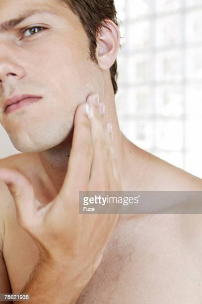 Man Examining Face