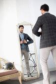 Man examining himself in mirror