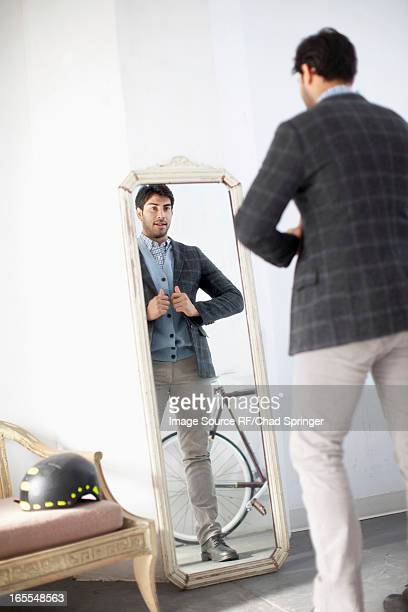 Man examining himself in mirror