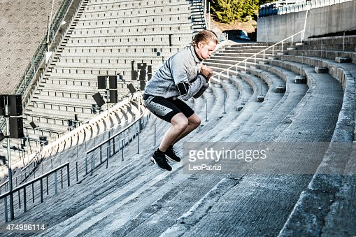 Man excercising in the city using urban structures