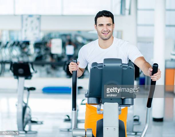 Man exercing on cross trainer