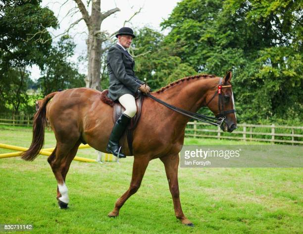 A man exercises his horse before competing during the 194th Sedgefield Show on August 12 2017 in Sedgefield England The annual show is held on the...