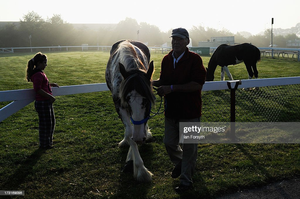 A man exercises his horses at the start of the Great Yorkshire Show on July 9, 2013 in Harrogate, England. The Great Yorkshire Show is the UK's premier agricultural event and brings together agricultural diplays, livestock events, farming demonstrations, food, dairy and produce stands as well as equestrian events to thousands of visitors over three days.