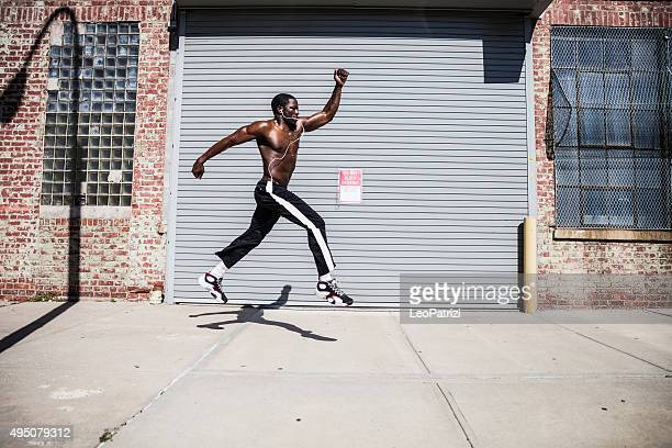 Man exercising and jumping in Queens streets - NY