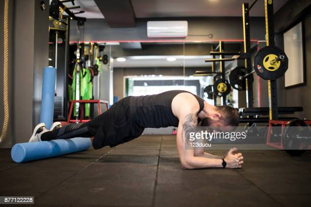 Man Exercising At Fitness Center