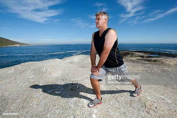 Man Exercising On Beach