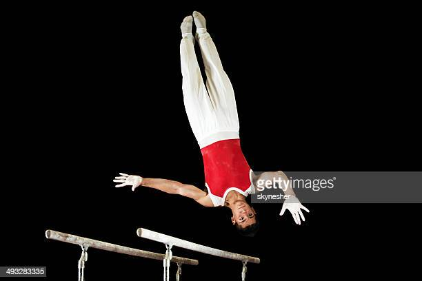 Man exercising on parallel bars.