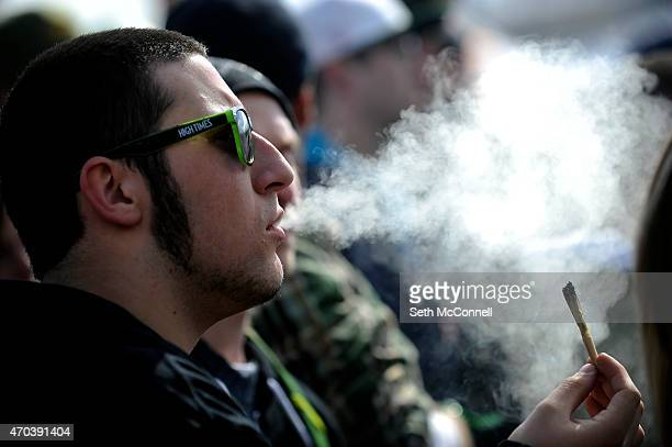 A man exhales marijuana smoke during the High Times Cannabis Cup at the Denver Mart in Denver Colorado on April 19 2015 The High Times Cannabis Cup...