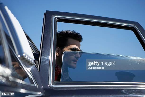 Man exiting car