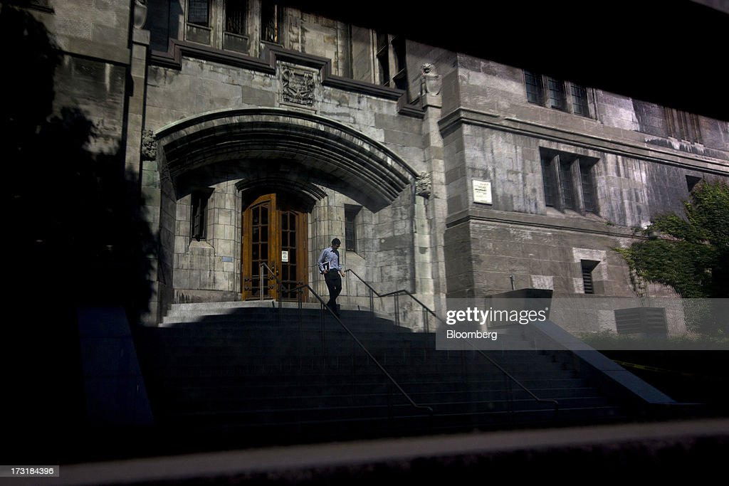 A man exits a building on the McGill University campus in Montreal, Quebec, Canada, on Monday, July 8, 2013. Montreals city council elected Laurent Blanchard as interim mayor to replace Michael Applebaum, who quit last week after being arrested on corruption charges. Photographer: Brent Lewin/Bloomberg via Getty Images