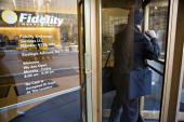 A man exits a Fidelity branch in New York US on Tuesday Feb 24 2009 Fidelity Investments Charles Schwab Corp and other 401 account managers say most...