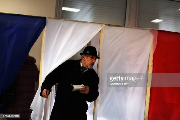 A man exits a polling booth inside a polling station on March 16 2014 in Simferopol Ukraine Crimeans go to the polls today in a vote that which will...