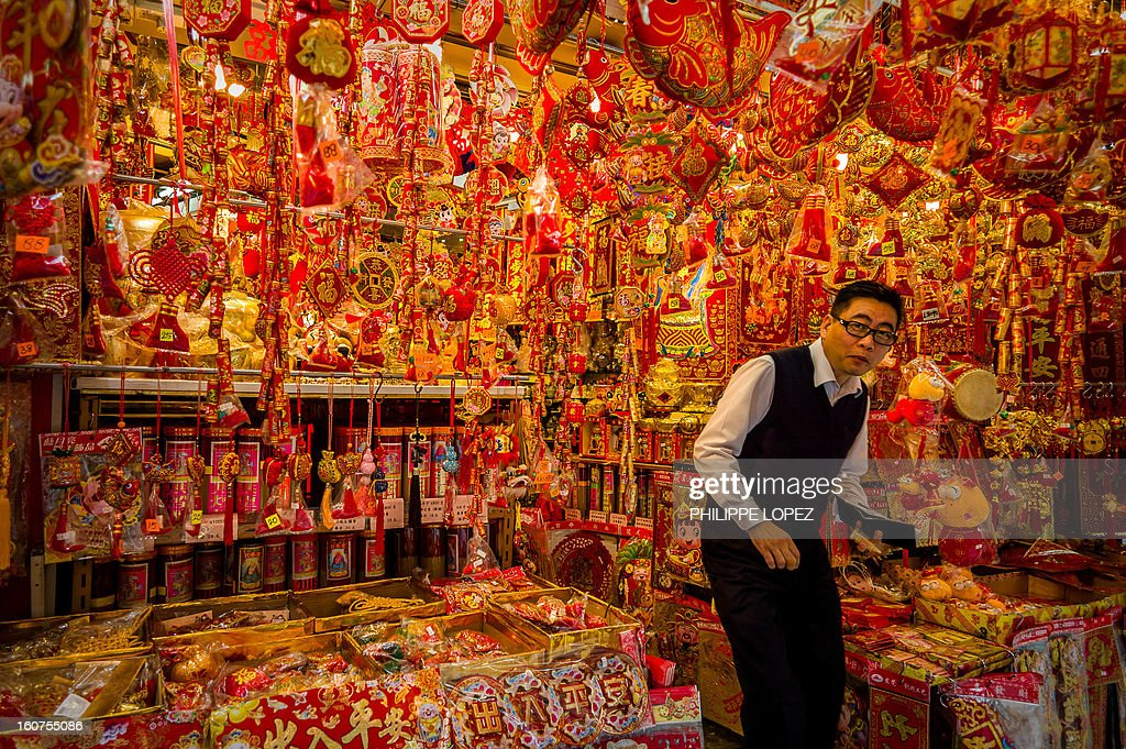 A man exits a shop selling Chinese New Year decorations in Hong Kong on February 5, 2013. The Chinese New Year festival falls on February 10, 2013. AFP PHOTO / Philippe Lopez