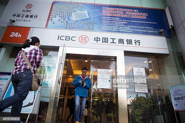 A man exits an Industrial and Commercial Bank of China Ltd branch in the central business district of Guangzhou Guangdong province China on Monday...
