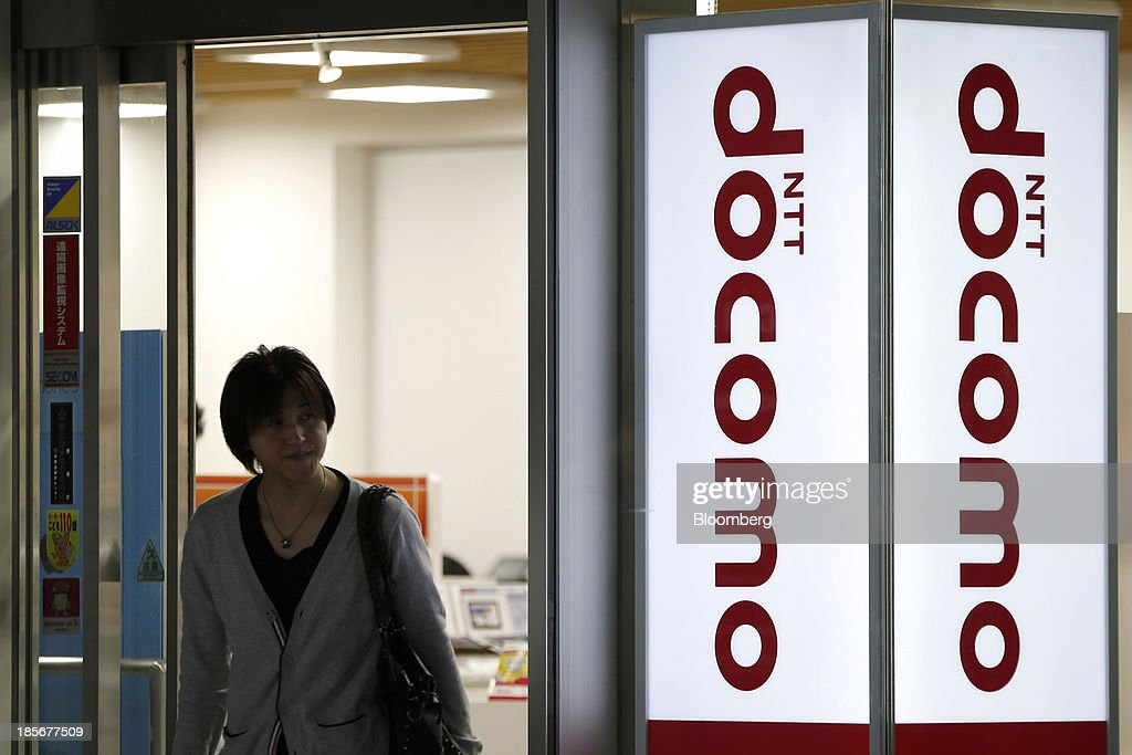 A man exits an NTT Docomo Inc. store in Tokyo, Japan, on Wednesday, Oct. 23, 2013. DoCoMo, Japan's largest mobile phone carrier, is scheduled to release earnings results on Oct. 25. Photographer: Kiyoshi Ota/Bloomberg via Getty Images