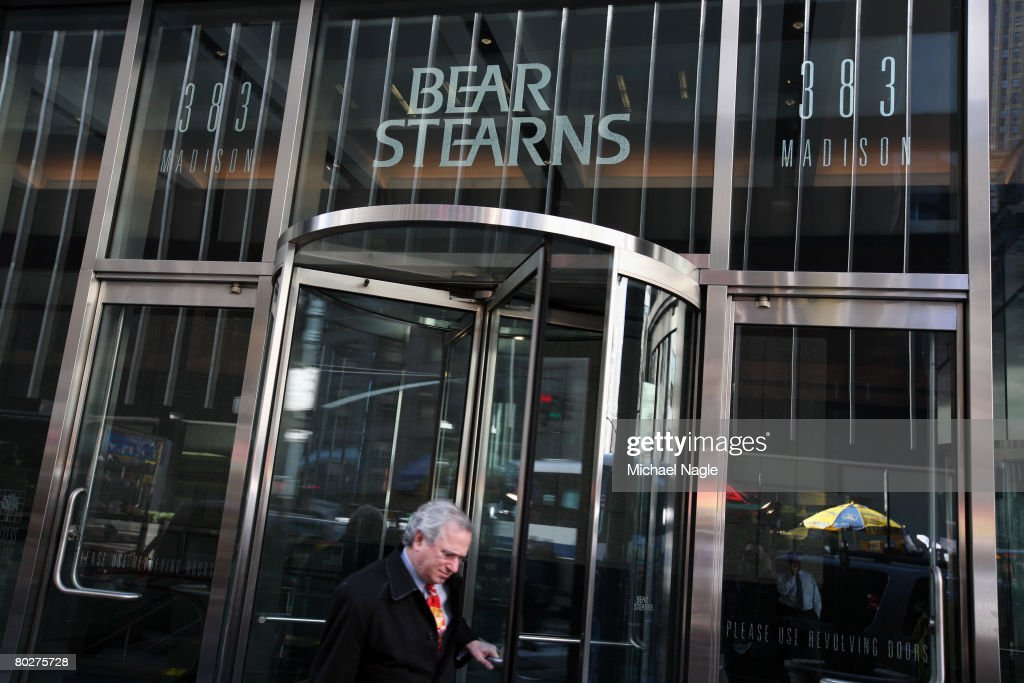 A man exits the offices of global investment bank securities trading and brokerage firm Bear Stearns Co on Madison Ave on March 17 2008 in New York...