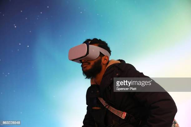 A man experiences Google's new Daydream View VR headset at a New York City popup shop on October 19 2017 in New York City The temporary store in the...