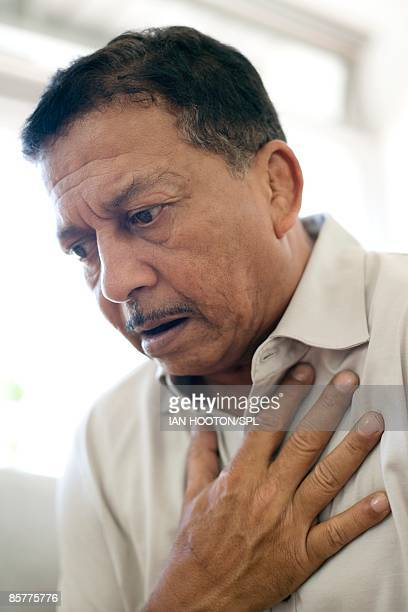 Man experiencing pain in chest