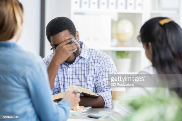 Man expresses his emotions during Bible study