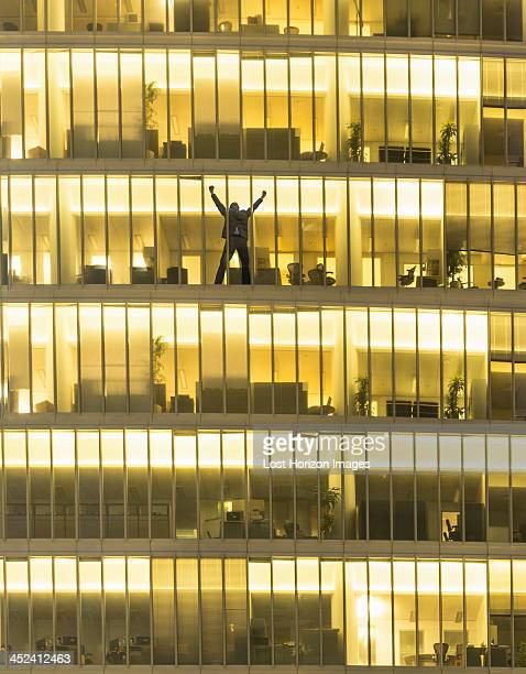 Man exulting in office