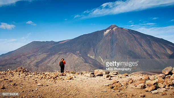 Man facing Teide volcano on canary island Tenerife