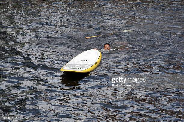 A man fall off his standup paddleboard during day one of the Jever SUP World Cup 2009 on July 10 2009 in Hamburg Germany