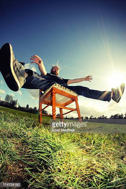 Man falling backwards on chair