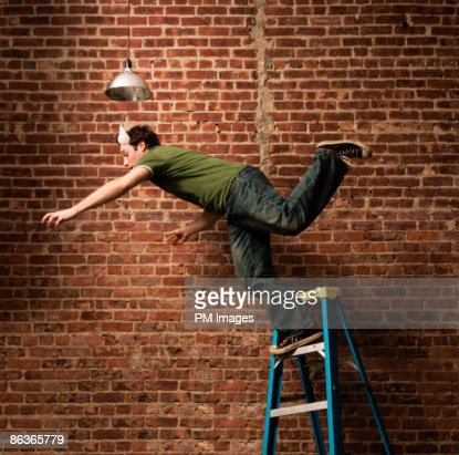 Man falling from ladder
