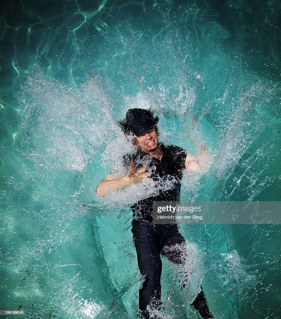 Man falling in pool : Stock Photo