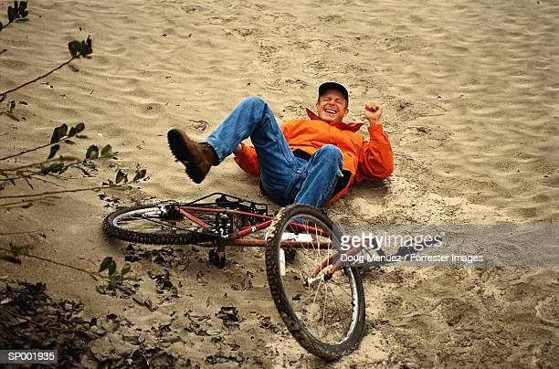 Man Falling off Bicycle