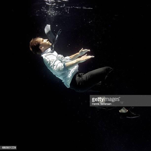 Man falling through water