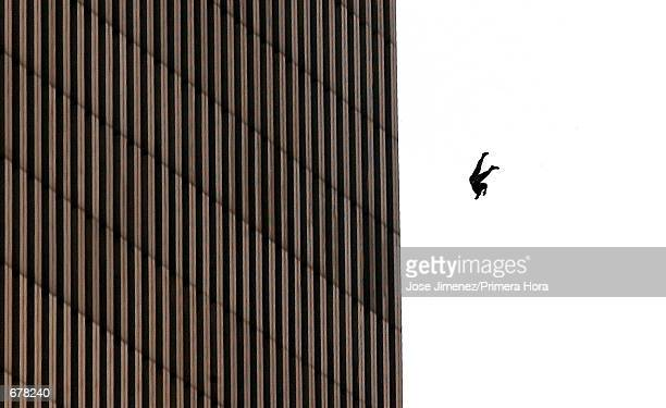 A man falls to his death from the World Trade Center after two planes hit the twin towers September 11 2001 in New York City in an terrorist attack