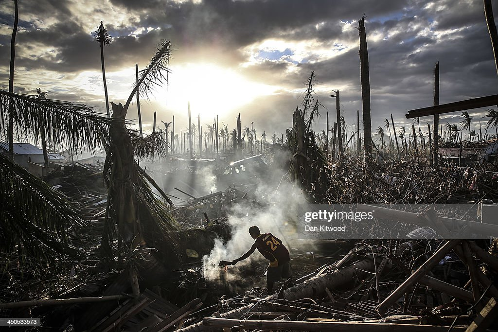 A man fans flames on a fire Tanauan on November 19, 2013 in Leyte, Philippines. Typhoon Haiyan which ripped through Philippines over a week ago has been described as one of the most powerful typhoons ever to hit land, leaving thousands dead and hundreds of thousands homeless. Countries all over the world have pledged relief aid to help support those affected by the typhoon however damage to the airport and roads have made moving the aid into the most affected areas very difficult. With dead bodies left out in the open air and very limited food, water and shelter, health concerns are growing.