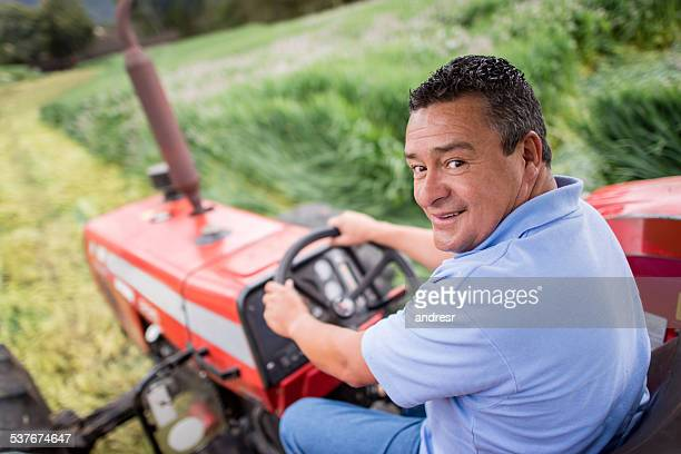 Man farming and driving a tractor