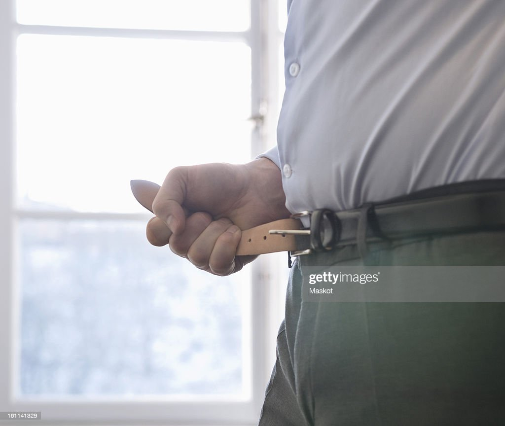 Man fasten his belt