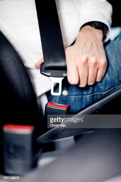 Man fastening seat belt
