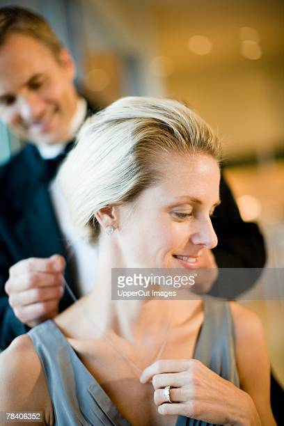 Man fastening wife's necklace