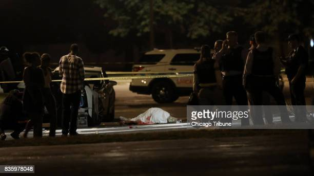 A man fatally shot lies in the parking lot of an event center in the 11900 block of South Loomis Street Sunday Aug 20 in Chicago Ill Six others were...